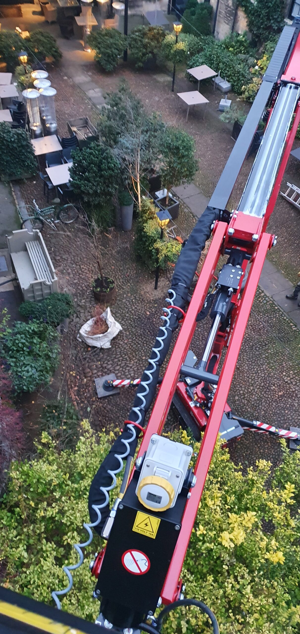 Warren Access trim ivy at The George of Stamford with the 17m Hinowa 17.75 spider lif,t part of the access platform hire fleet